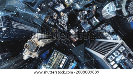 Aerial. Camera moving around buildings. Wireless communication network concept. IoT Internet of Things. ICTInformation Communication Technology. Royalty-Free Stock Photo #2008009889
