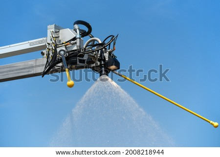 Special faucet for treating aircraft with anti-icing liquid.