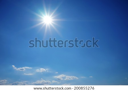 The sun shines bright in the daytime in summer. Blue sky and clouds.   #200855276