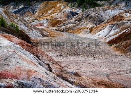 Landscape like a planet Mars surface. Ural refractory clay quarries. Nature of Ural mountains, Russia. The hardened red-brown surface of the earth. For screensaver for desktop, banner, cover.