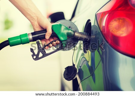 transportation and ownership concept - man pumping gasoline fuel in car at gas station Royalty-Free Stock Photo #200884493