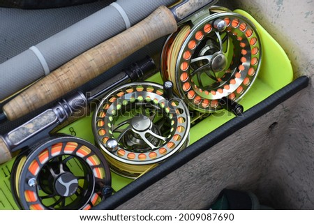 A collection of fly rods and reels  Royalty-Free Stock Photo #2009087690