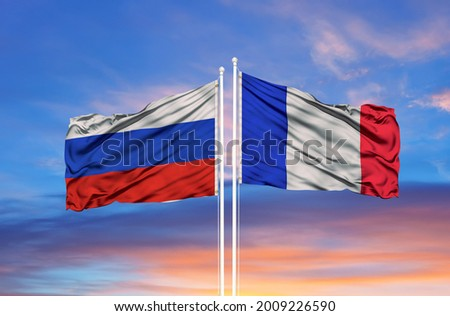 France and Russia two flags on flagpoles and blue cloudy sky Royalty-Free Stock Photo #2009226590