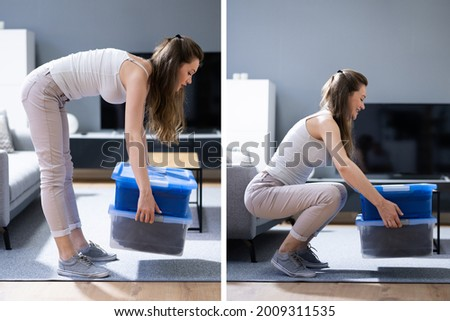 Incorrect Box Lifting Posture. Heavy Weight Lift Royalty-Free Stock Photo #2009311535