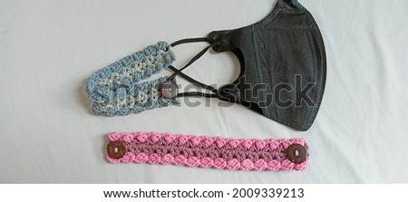 Handmade crochet mask connector for hijab.  Earloop mask converter to headband mask.  handmade on a white background
