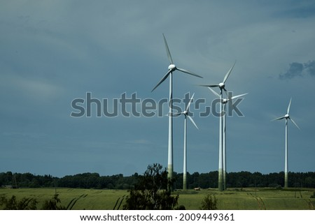 Power of wind turbine generating electricity clean energy with cloud background on the sky.Global ecology.Clean energy concept save the world. High quality photo Royalty-Free Stock Photo #2009449361