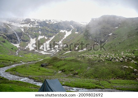 High altitude Bhrigu lake trek on meadows and snow capped mountains Royalty-Free Stock Photo #2009802692