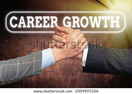 Text caption presenting Career Growth. Conceptual photo Development Ambitions Attainment Motivation Progress in company Two Professional Well-Dressed Corporate Businessmen Handshake Indoors