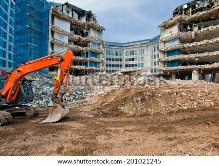 Pieces of Metal and Stone are Crumbling from Demolished  Royalty-Free Stock Photo #201021245