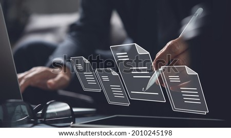 E-signing, electronic signature, document management, paperless office concept. Businessman using stylus pen signing on e document on digital tablet on tablet and virtual notepad on virtual screen