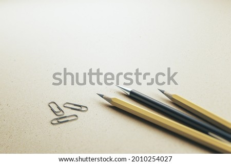Close up of pencils and paper clips on white desk background, Stationery concept. Mock up, 3D Rendering