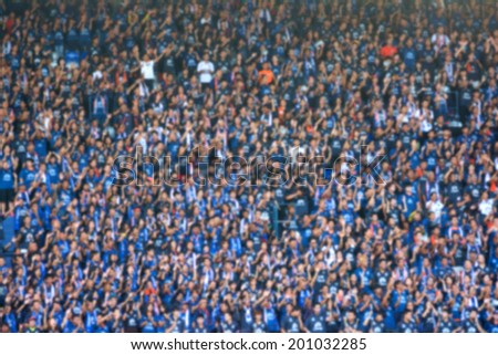 Blurred crowd of spectators on a stadium with a football match. Royalty-Free Stock Photo #201032285