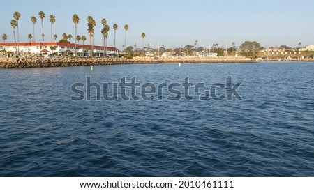 View of sea water from sailing boat or yacht, Oceanside harbor, summer vacations in California USA. Seascape from sailboat in port, tropical marina harbour. Pacific ocean coast, whale watching tour.
