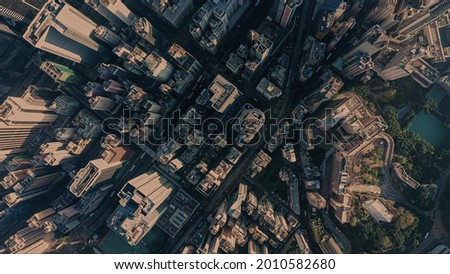 AERIAL view of the huge city at the sunset. Drone footages of Hong Kong city.  Royalty-Free Stock Photo #2010582680