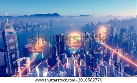 Financial technology concept. Fintech. Crypto currency. Electronic money. Cashless payment. Currency symbols on the Hong Kong financial centre citys background. Aerial shot. Royalty-Free Stock Photo #2010582776