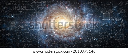 Mathematical and physical formulas against the background of a galaxy in universe. Space Background on the theme of science and education. Elements of this image furnished by NASA. Royalty-Free Stock Photo #2010979148