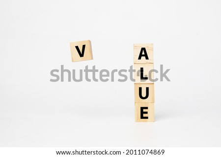 A picture of levitation V word wooden block from ALUE word. Creating value concept