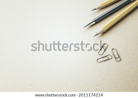 Close up of pencils and paper clips on white mockup table background, Stationery concept. 3D Rendering