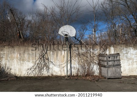 Old basketball court no longer in use. Photographed in the winter season.