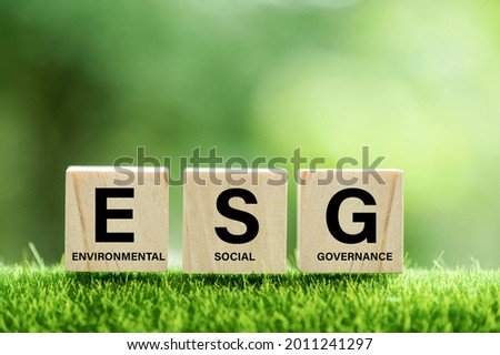 words ESG on a wood block and Future environmental conservation and sustainable ESG modernization development by using the technology of renewable resources to reduce pollution and carbon emission. Royalty-Free Stock Photo #2011241297