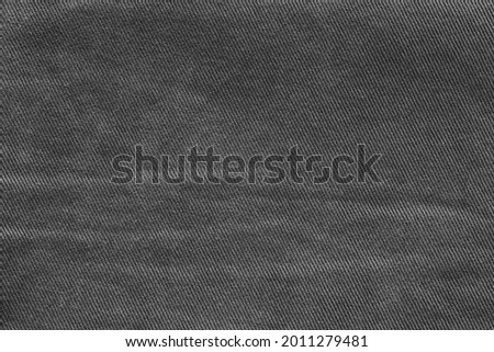 texture of dark worn black denim close-up for empty background or for desktop wallpaper Royalty-Free Stock Photo #2011279481