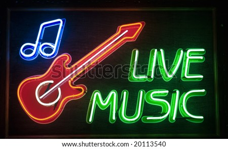 """live music"" inscription and red guitar symbol"