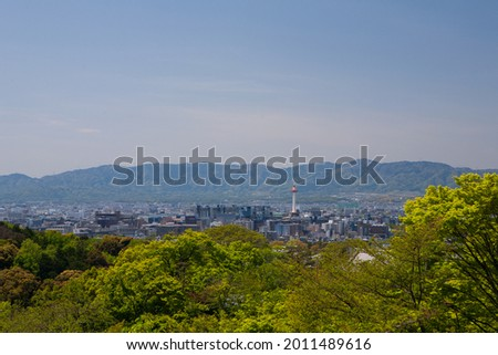 Kiyomizudera Temple or a clear water temple is surrounded by green forest in the sunlight on a clear day. It reveals a picture of the beauty of architecture and culture that attracts many tourists.