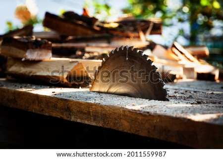circular power saw for cutting wood. circular saw blade on a wooden machine. Royalty-Free Stock Photo #2011559987