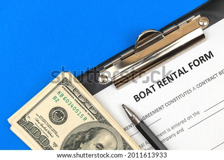Boat rental form. Clipboard with official agreement, pen and money. Top view