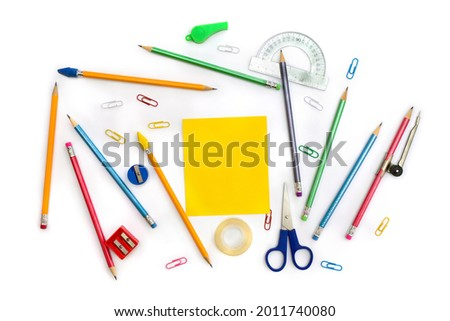 Back to School. School supplies ( yellow sheet, pencil, scissors, sharpener, clips, crayons ) on a white background. Top view, flat lay Royalty-Free Stock Photo #2011740080