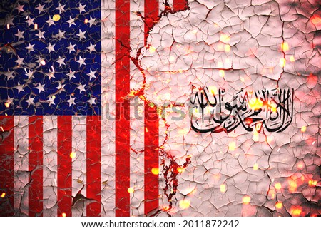 Us and Taliban flags painted over cracked concrete wall.And lava flows behind.Us vs Taliban war. Royalty-Free Stock Photo #2011872242