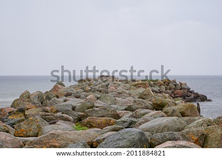 Rocky coastal landscape scene at shore of ocean. High quality photo Royalty-Free Stock Photo #2011884821