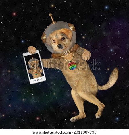 A beige dog astronaut wearing a space suit with a smartphone is in outer space.