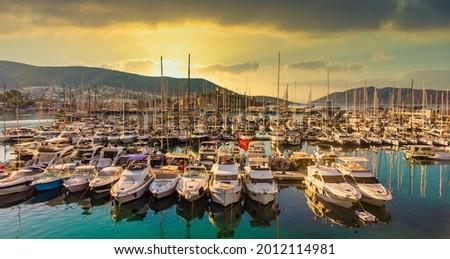 Sunset sea yachts in yacht port Bodrum. Yachting sunset scene. Sunset yachts view. Yachts in sunset bay. Yalikavak Bodrum Marina, sailing boats and yachts in Bodrum Royalty-Free Stock Photo #2012114981