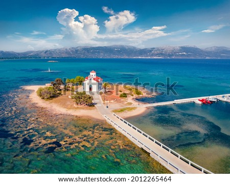 View from flying drone of Saint Spiridon church in Elafonisos port. Colorful morning seascape of Mediterranean Sea. Spectacular outdoor scene of Elafonisos island, Greece. Traveling concept background Royalty-Free Stock Photo #2012265464