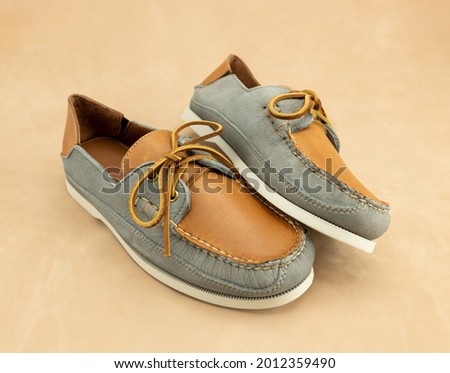 Classic men's leather boat shoes. These laced loafers are the traditional fashion accessory for preppy boating male.