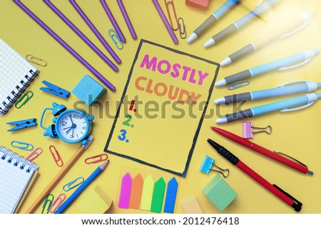 Text caption presenting Mostly Cloudy. Conceptual photo Shadowy Vaporous Foggy Fluffy Nebulous Clouds Skyscape Flashy School And Office Supplies Bright Teaching And Learning Collections