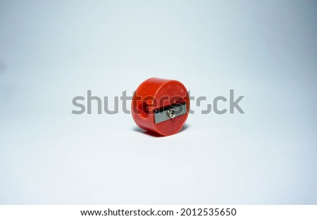 Red pencil sharpener isolated on a white background Royalty-Free Stock Photo #2012535650