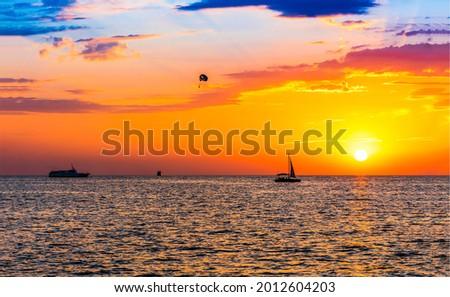 Sunset over the sea horizon. Sunset sea horizon. Sunset sea horizon. Sunset sea sky Royalty-Free Stock Photo #2012604203