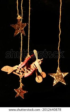 Cartoon black background, back to school, wooden plane, paper gold stars