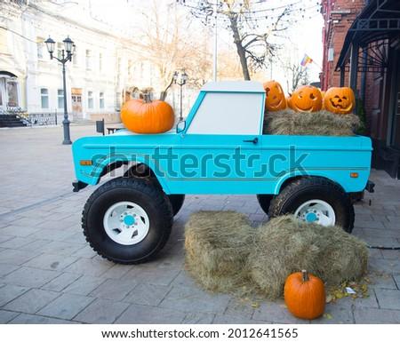 A large bright ripe pumpkin Jack-o-lantern photo place