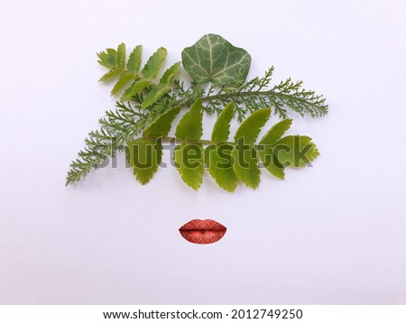 Flat lay photography. Frida Kahlo face abstract representation with leaves. Mexican artist painter. Abstract concept. Royalty-Free Stock Photo #2012749250
