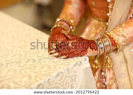 Pakistani indian bride and groom hand Pictures and showing wedding rings and Wrest Watch,