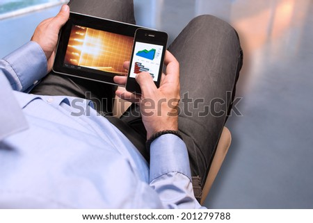 Businessman checking data on smartphone and digital tablet #201279788