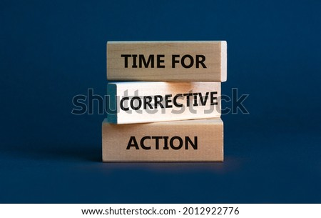 Time for corrective action symbol. Wooden blocks with words 'Time for corrective action' on a beautiful grey background. Business, time for corrective action concept. Copy space. Royalty-Free Stock Photo #2012922776