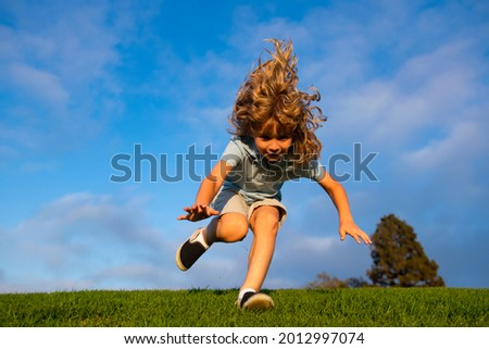 Boy falling down on grass. Kid falling off at the park. Child insurance and childcare. Royalty-Free Stock Photo #2012997074