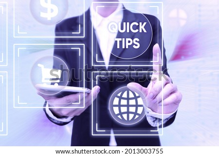 Text sign showing Quick Tips. Business overview small but particularly useful piece of practical advice Lady In Uniform Holding Phone Pressing Virtual Button Futuristic Technology.