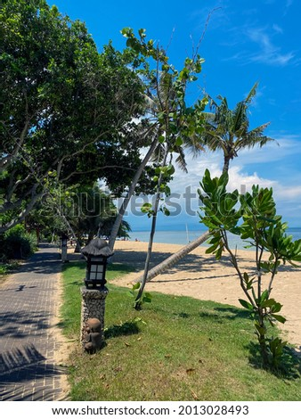 Stunning beautiful beach with relaxing scenery on a beach. Famous travel destination in Sanur, Bali, Indonesia. - stock photo. High quality photo