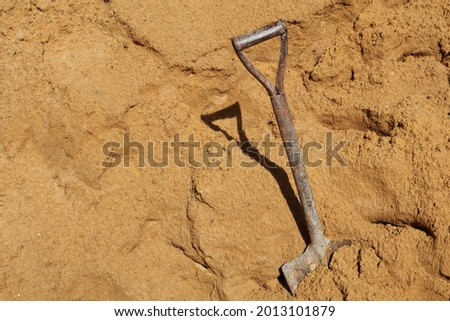 Shovel placed used for scoop sand in construction work,sand material for construction work.