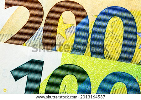 Selective focus on detail of EURO banknotes. Close up macro detail of EURO banknotes Royalty-Free Stock Photo #2013164537